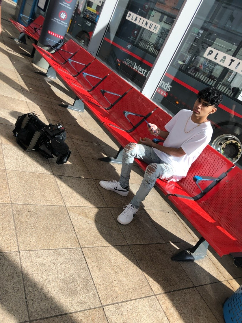 Anish Parmar working with the BBC, ITV & BirminghamTV at Wolverhampton Bus Station in the United Kingdom.